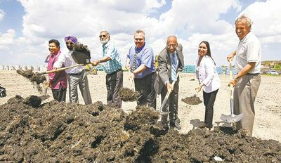 Point Douglas Coun. Mike Pagtakhan (from left), Terrascape Developments president Kuljit Ghuman, Darshan Kaila of SGS Properties, Winnipeg School Division trustee Mike Babinsky, Maples MLA Mohinder Saran, Old Kildonan MLA Devi Sharma and David Palubeski, president of Lombard North, break ground on Waterford Green