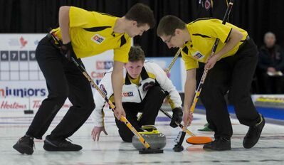 Manitoba skip Braden Calvert throws a rock during the men's final at the M&M Meat Shops Junior Curling championship in Liverpool, N.S. Sweeping for him are lead Brendan Wilson and second Lucas Van Den Bosch. Manitoba won the match.