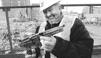 KEN GIGLIOTTI / WINNIPEG FREE PRESS Imrie Demolition owner Wayne Imrie with a plastic toy replica made by Mattel.