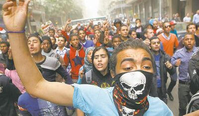 Egyptians shout anti-Muslim Brotherhood slogans during a march in Cairo Friday.