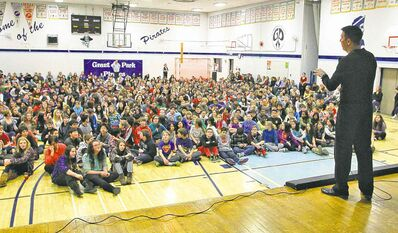 RCMP Const. Tad Milmine talks to a gym full of students at Grant Park High School Monday about growing up a victim of bullying.