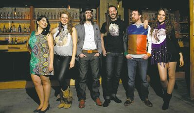 Juno Fashion is the theme and local musicians model the clothes in the Union Sound Hall. From left Marti Sarbit, Sheena Rattai, Daniel Jordan, Daniel Peloquin-Hopfner, Rusty Matyas and Sierra Noble.