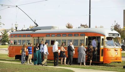 In this Sept. 28, 2013 photo, passengers board the Johnstown (Kenosha) streetcar during Kenosha Streetcar Day in Kenosha, Wis. Long after the streetcar was driven to the edge of extinction in America by the automobile _ hanging on only in a few places like New Orleans and Philadelphia _ cities are spending millions putting them back in, often along the same stretches of pavement where rail was wrenched out decades ago. The idea is that streetcars can form the heart of communities built around them, igniting economic development in urban centers that badly need it and offering a whiff of excitement to boot. (AP Photo/Michael Schmidt)
