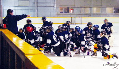 Students at Starbuck Hockey Academy receive instructions from coach Curt Ketchen.