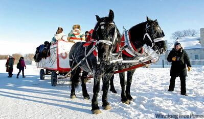 A horsedrawn cart shuttles loads of people around Lower Fort Garry.