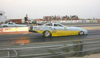 Yeah, those are flames shooting out the back! A pair of high-powered jet funny cars that run on canola oil thrilled the crowd with big sound and serious speed.
