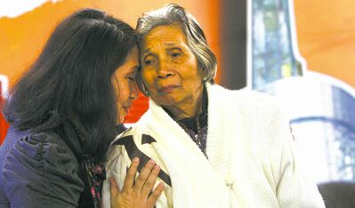 Therapist Cristina Rosello comforts Fidencia David, 86, one of the last living  'comfort women' Japanese soldiers raped as they pillaged the Philippines in the Second World War. Even today, 72 years later, David is overcome with emotion when telling of her experience.