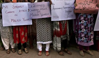 Pakistani women, hold banners during a protest on Wednesday condemning the attack on schoolgirl Malala Yousufzai, in Islamabad, Pakistan.