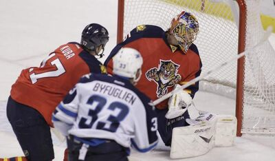 Winnipeg Jets' Dustin Byfuglien scores the OT winner on Florida Panthers' goalie Jacob Markstrom in Sunrise, Fla., on Friday night.