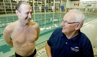 Former Olympian Gabor Csepregi shares a light moment with old pal and swim coach Pal Temesvari at the University of Manitoba pool.