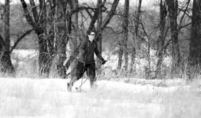 A woman cross-country skis in Wildwood Park on April 14.