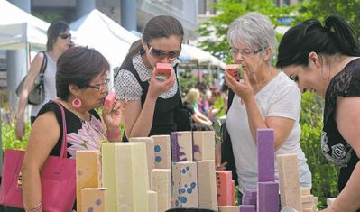Watermelon soap seems to be popular at one of the stalls at the Downtown Winnipeg Farmers Market, open Thursdays at the Manitoba Hydro Place Plaza until October.   Mike Deal / Winnipeg Free Press
