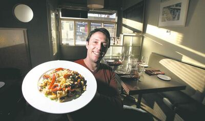 Joel Boulet, one of the owners at Cafe Carlo on Lilac Street, brandishes the cafe's signature dish, fett Chile.