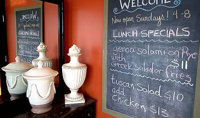 Urns and menus as well as comfortable seating greet diners at the Steve's Bistro.