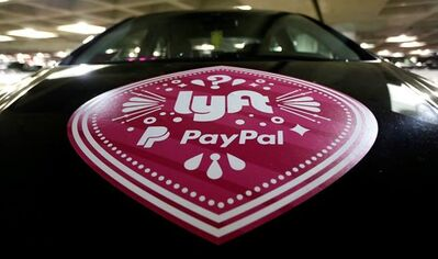 A vehicle with the logo from the Lyft ride sharing service is shown at Seattle-Tacoma International Airport, Thursday, March 31, 2016 in Seattle. THE CANADIAN PRESS/AP-Ted S. Warren