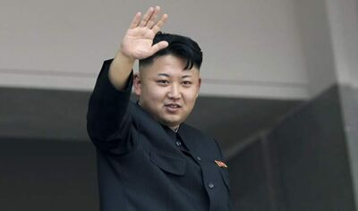 In this file photo, North Korea's leader Kim Jong Un waves to spectators and participants of a mass military parade celebrating the 60th anniversary of the Korean War armistice in Pyongyang, North Korea.