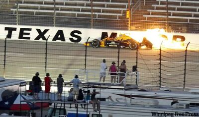 Simona De Silvestro is engulfed in flame as her Team Stargate Worlds/HVM car hits the wall in turn two and goes down the back straightaway during the IZOD IndyCar Series Firestone 550 at Texas Motor Speedway in Fort Worth, Texas Saturday.