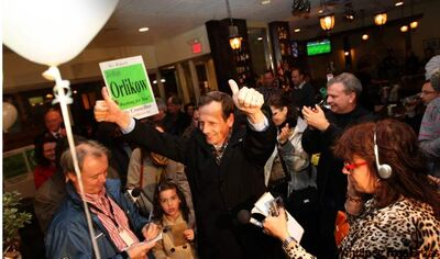 John Orlikow gives two thumbs up to his supporters at The Grove Restaurant.