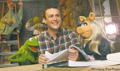 From left: Kermit the Frog, Jason Segel and Miss Piggy star in the new Muppet movie, which Segel wrote.