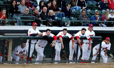 Winnipeg Goldeyes players look on from the dugout during the team's home opener against the Sioux City Explorers at Shaw Park Monday evening. The Explorers won 6-5.