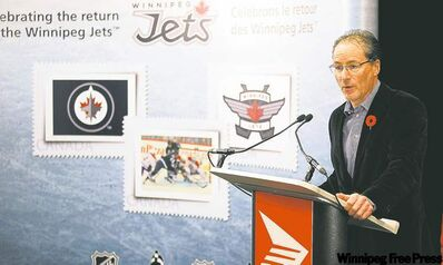 True North's Jim Ludlow gets a look at the three stamps for the first time at the unveiling at the MTS Centre Thursday.