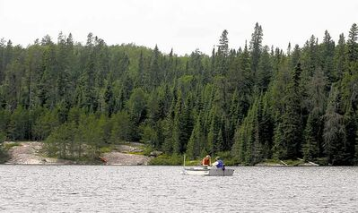 Researchers take water samples from at the Experimental Lakes Area near Kenora in 2008.
