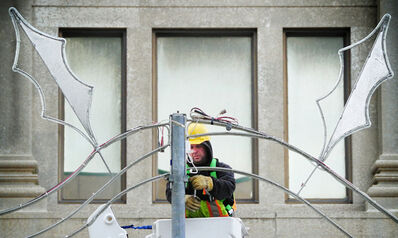 City crews seem to have taken note of the weather as they set up the winter holiday lights along Portage Avenue on Sunday morning.