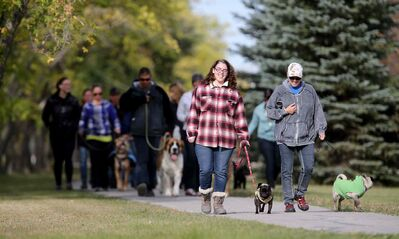 Participants head out on a 'pack walk' in St. Francois Xavier.