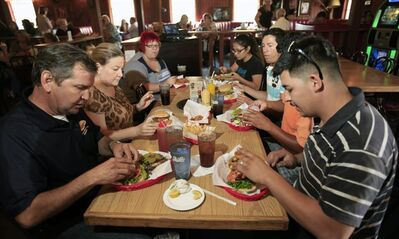 People dine at the Boll Weevil, during a fundraiser for Hannah Anderson and her family Thursday, Aug. 15, 2013 in Lakeside, Calif. The father of Hannah Anderson, the 16-year-old girl who was abducted by a longtime family friend and rescued during an FBI shootout in the Idaho wilderness says his daughter is spending time with family and friends and happy to be home. (AP Photo/U-T San Diego, Howard Lipin) NO SALES; COMMERCIAL INTERNET OUT