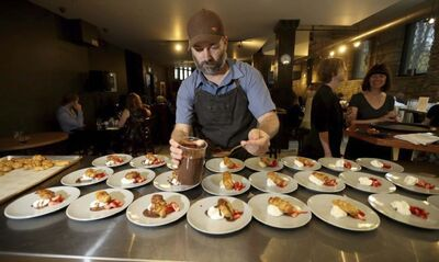 TREVOR HAGAN / WINNIPEG FREE PRESS</p><p>Chef Ben Kramer completes the dessert course during the Mothers Day Sunday Brunch Collective.</p>