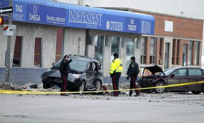 Winnipeg police at the scene of a collision on Isabel Street. The driver responsible may face up to seven years in prison.