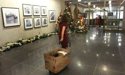 City clerk Josie Marques moves boxes into offices on the main floor of  city hall's  administration building.