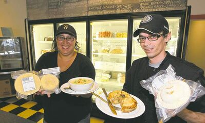 Charisse  Hackman and Alain Manaigre with some of the flash-frozen fare available  at Frozen Comfort.