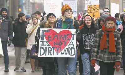 About 250 participants marched to mark International Women's Day Friday.