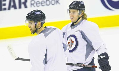 Jets captain Andrew Ladd (left) and Bryan Little know the players have to improve as individuals and a team before they can call each other to account for poor play.