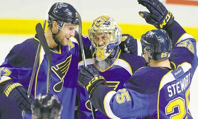 Blues goalie Jaroslav Halak is congratulated by teammates Alex Pietrangelo and Chris Stewart after their win.