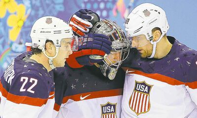 USA defenseman Kevin Shattenkirk, goaltender Jonathan Quick and forward Blake Wheeler celebrate their 5-2 win over the Czech Republic after the men's quarterfinal hockey game in Shayba Arena at the 2014 Winter Olympics, Wednesday, Feb. 19, 2014, in Sochi, Russia.