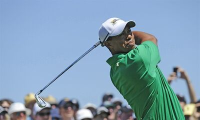 Tiger Woods of the U.S. team hits an approach shot during a practice round prior to the start of the Presidents Cup golf tournament at Royal Melbourne Golf Course, in Melbourne, Australia, Tuesday, Nov. 15, 2011. (AP Photo/Andrew Brownbill)