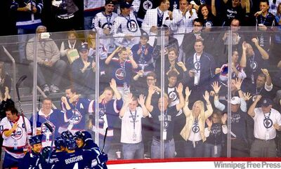 Fans erupt at a raucous MTS Centre as the home team celebrates the new-era Winnipeg Jets' first goal, a third-period marker scored by NIk Antropov.