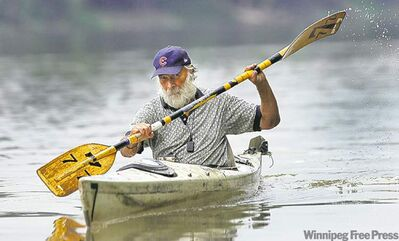 Don Starkell in his 19-year-old kayak on the Red River back in August of 2009.