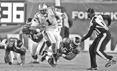 Jeff Siner / mcclatchey news serviceQB Cam Newton carried the Panthers to victory over the Eagles Monday.