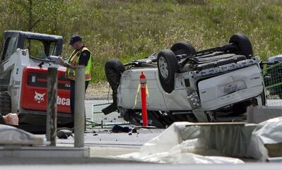 Police investigate the aftermath of a fatal car crash at the intersection of 176th Street and 32nd Avenue in Surrey, B.C. on Sunday, April 28, 2013. RCMP in British Columbia say five people are dead after a serious crash near the U.S border.THE CANADIAN PRESS/Eric Dreger