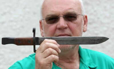 Bill Anderson with his bayonet for a Ross rifle part of his  grandfather's First World War memorabilia.