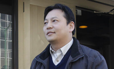 Joe Chan leaves the Law Courts Building in April during the first court case.