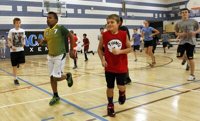 Acadia Junior High School students take part in warm-up exercises in their gym class. Of the 65,218 Manitoba students surveyed in 2012/13, 46 per cent participate in the recommended amount of daily physical activity.