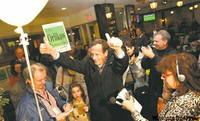A victorious John Orlikow gives two thumbs up to his supporters after arriving at The Grove Restaurant.