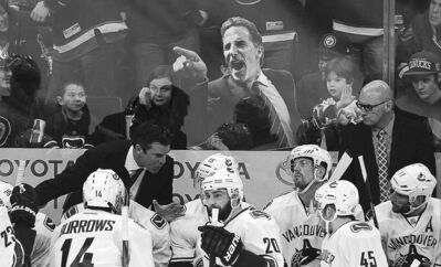Winnipeg Jets fans taunt the Vancouver Canucks with a cardboard cutout  of suspended coach John Tortorella.