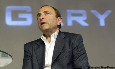 National Hockey League commissioner Gary Bettman speaks in Toronto on August 25, 2010.