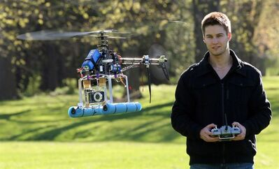 Chris Bacik, a 22-year-old Western University student flies his remote-controlled helicopter that he modified to carry a camera for aerial photography and video, in London, Ontario. Bacik has used the rig for capturing golf courses and cottages in Muskoka and has been awarded $5,000 in a business pitch competition for student entrepreneurs. He is now building a larger and improved unit for his business.