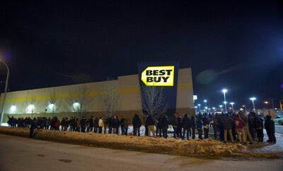 The freezing cold didn't stop customers from lining up for Boxing Day sales at the Best Buy on St. James Street in Winnipeg.